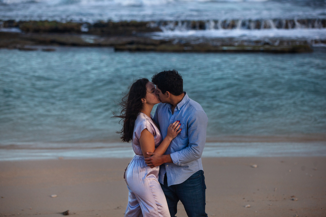 Giulia & Andrew | Maui Sunrise Portrait Session. Couples portrait session on Maui's north shore at sunrise. Mixture of greenery and blue water backdrops and a variety of candid and posed photographs. Scenic panoramic images to showcase Maui's landscape and natural beauty.