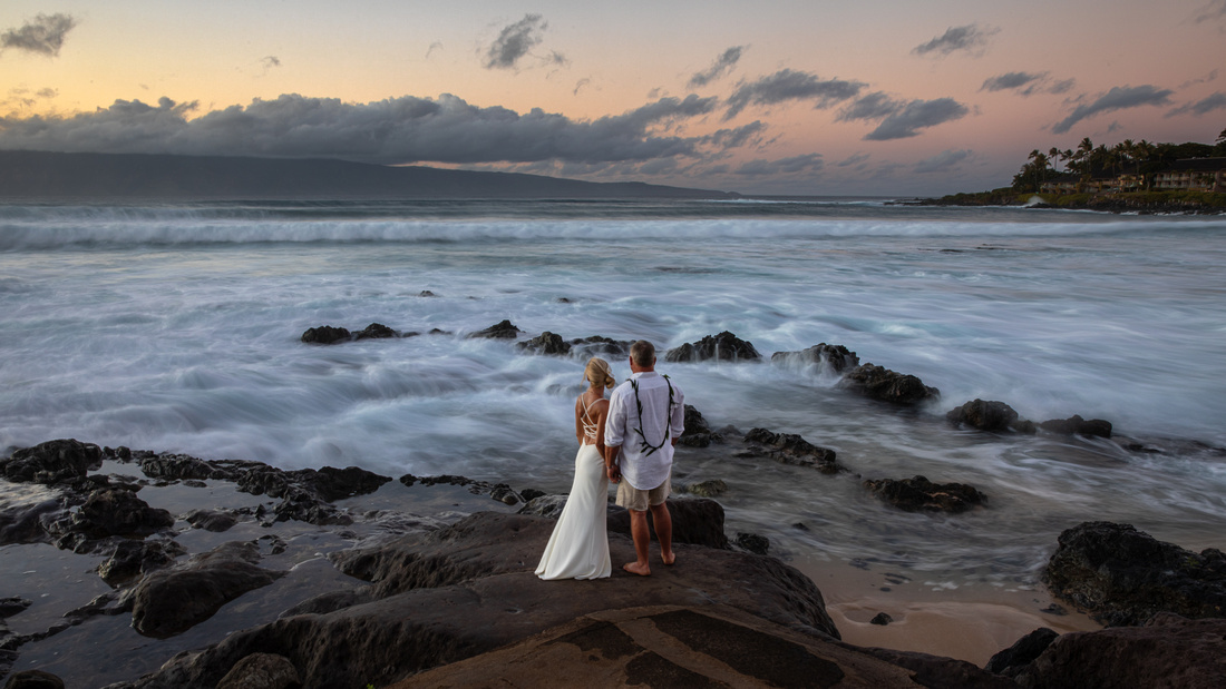 West Maui beach elopement at Napili Bay. Officiated by Kahu Kale Kaalekahi. Florals by Aloha Flower Co. Photography by Madelynne Lorraine.